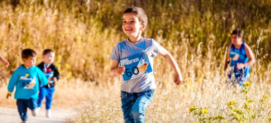 Young Boy Running Cross Country