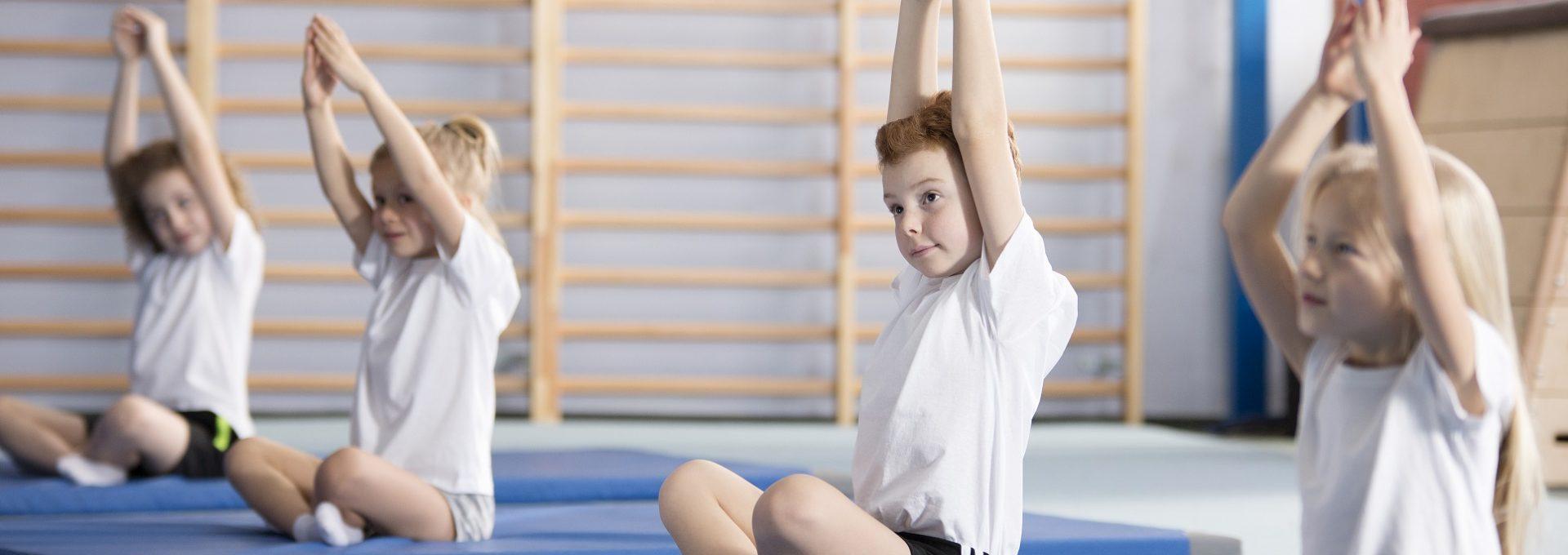 primary kids doing yoga