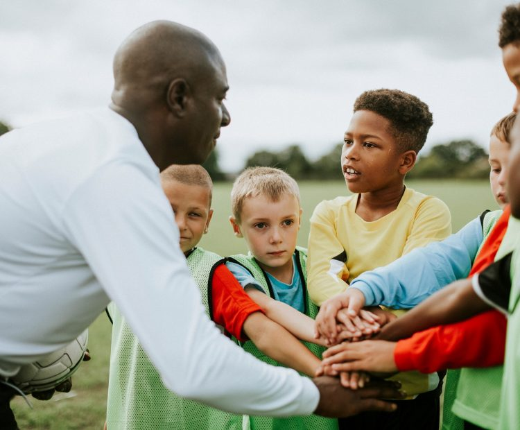 football coach with kids