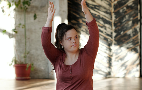 Girl with disability doing yoga