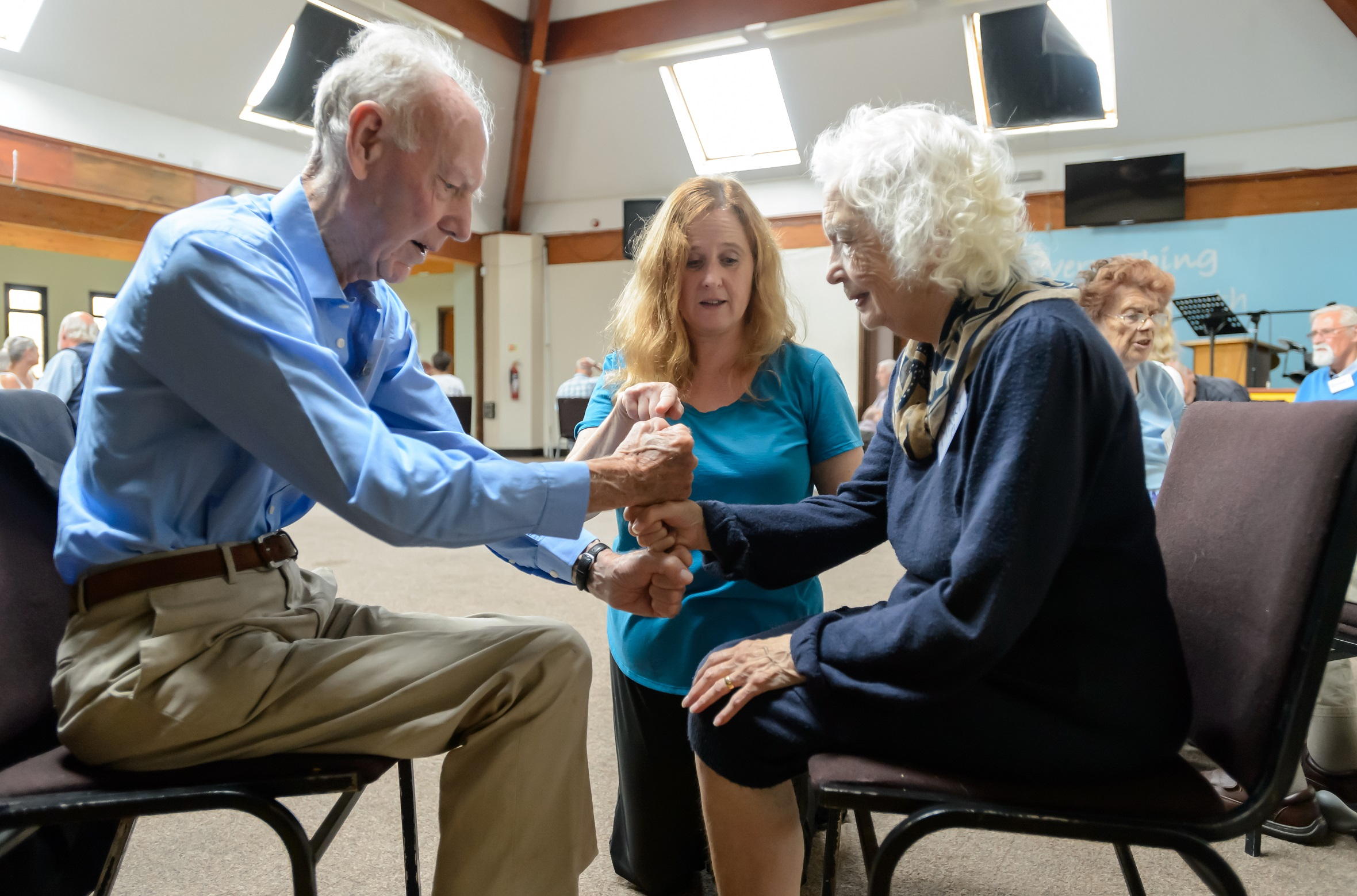 woman teaches older adults fitness