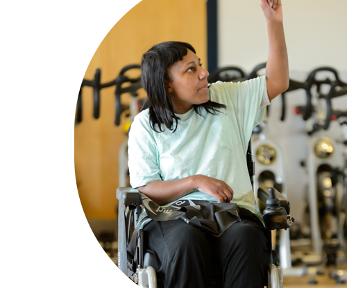 Woman in wheelchair in gym