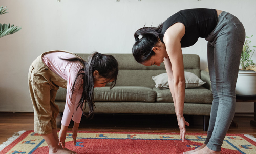 Woman and daughter stretching