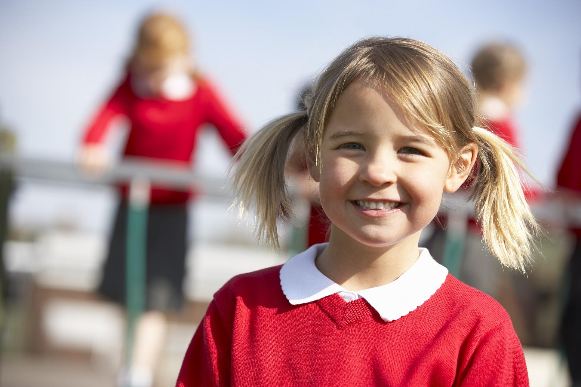 smiling girl in school uniform