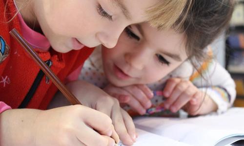 Girls writing a story