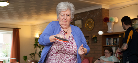 Older active woman playing ping pong