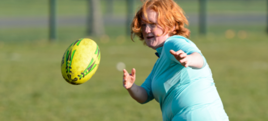 How active should I be: Woman throwing rugby ball