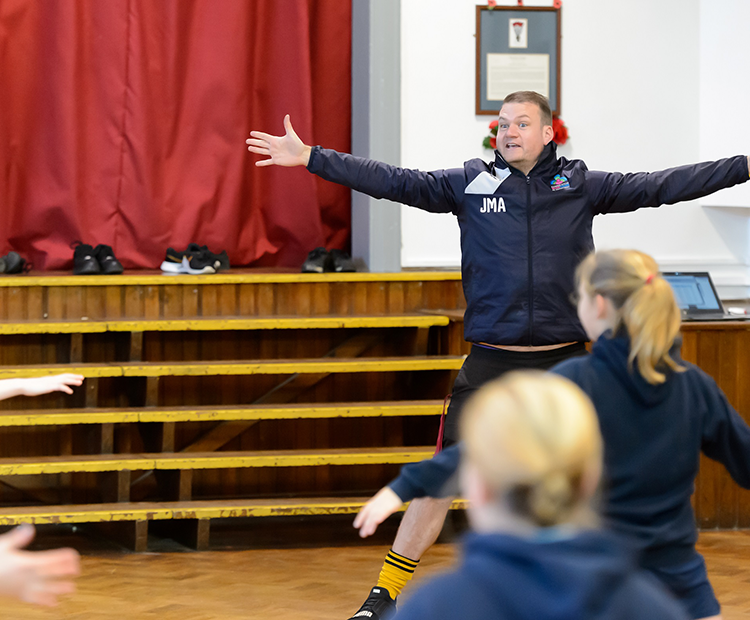 coach in school gym