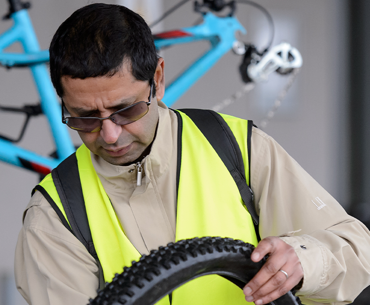 cycling volunteer fixes bike tire