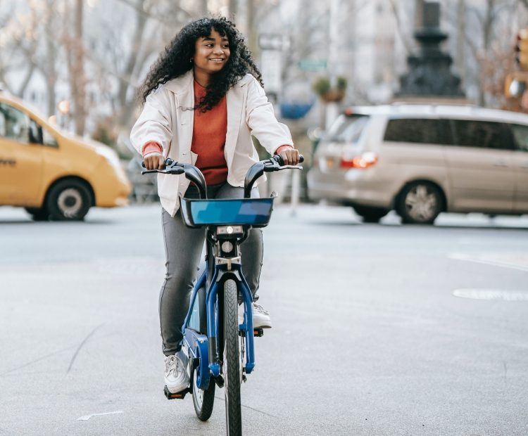young woman on bike in city