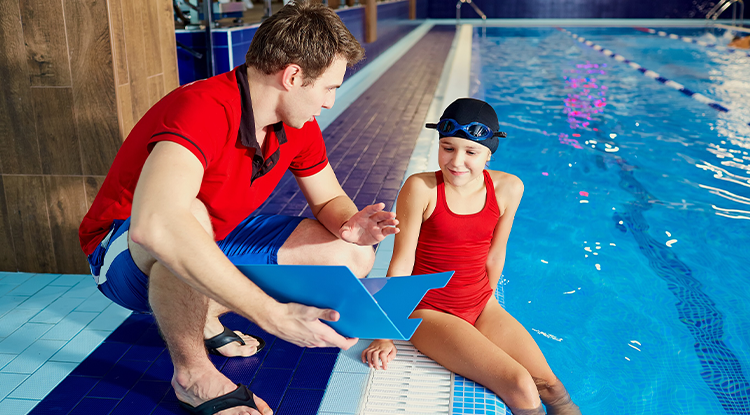 swim coach with swimmer