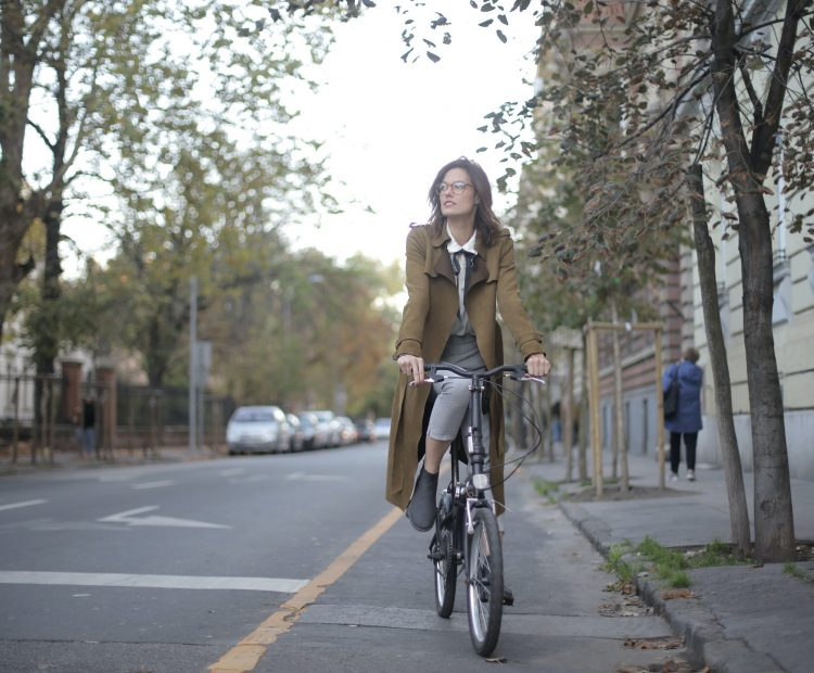woman cyclist in healthy streets cycle lane