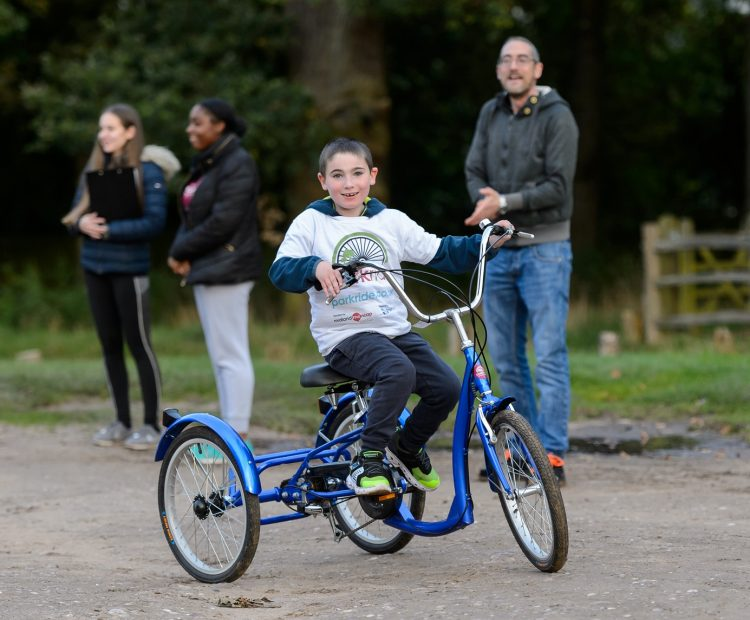 young disabled boy on adapted bicycle