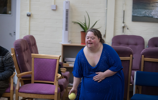 disabled woman throwing a ball