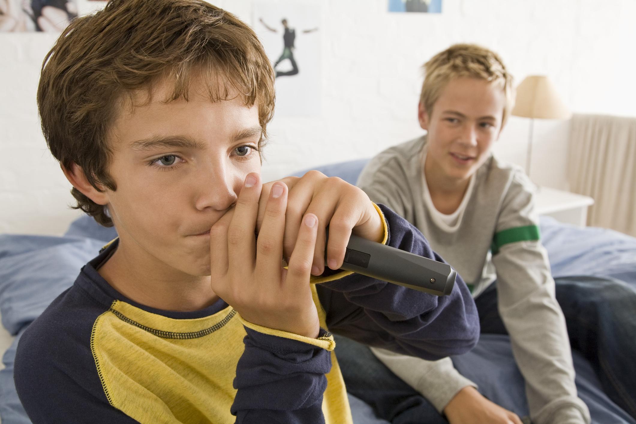 Teenage boys with microphone