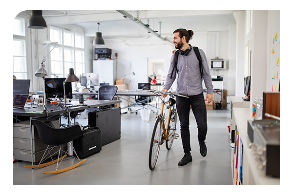 businessman with bike in office