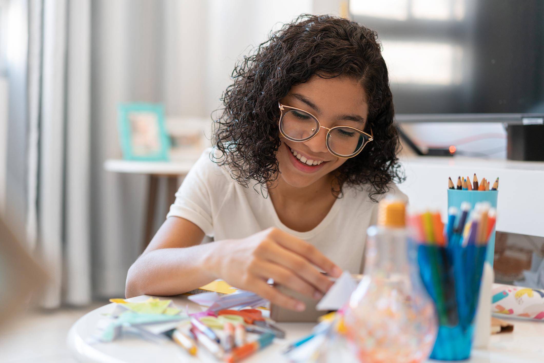 Teenage girl painting and drawing