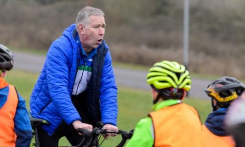 Man teaching kids cycling