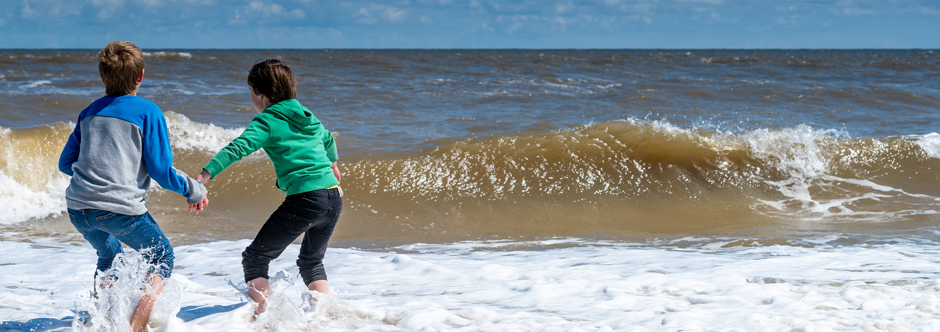 Two boys playing on Norfolk beach