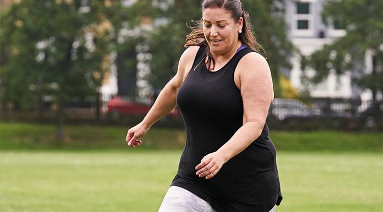 lady plays football
