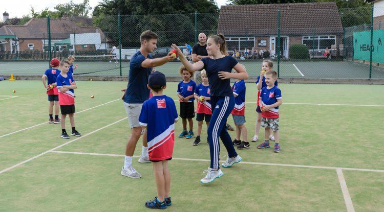 tennis coaching kids outdoors