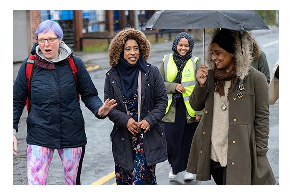 women walking for health in rain