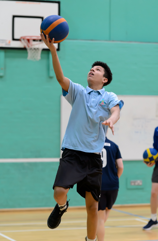 young man plays basketball