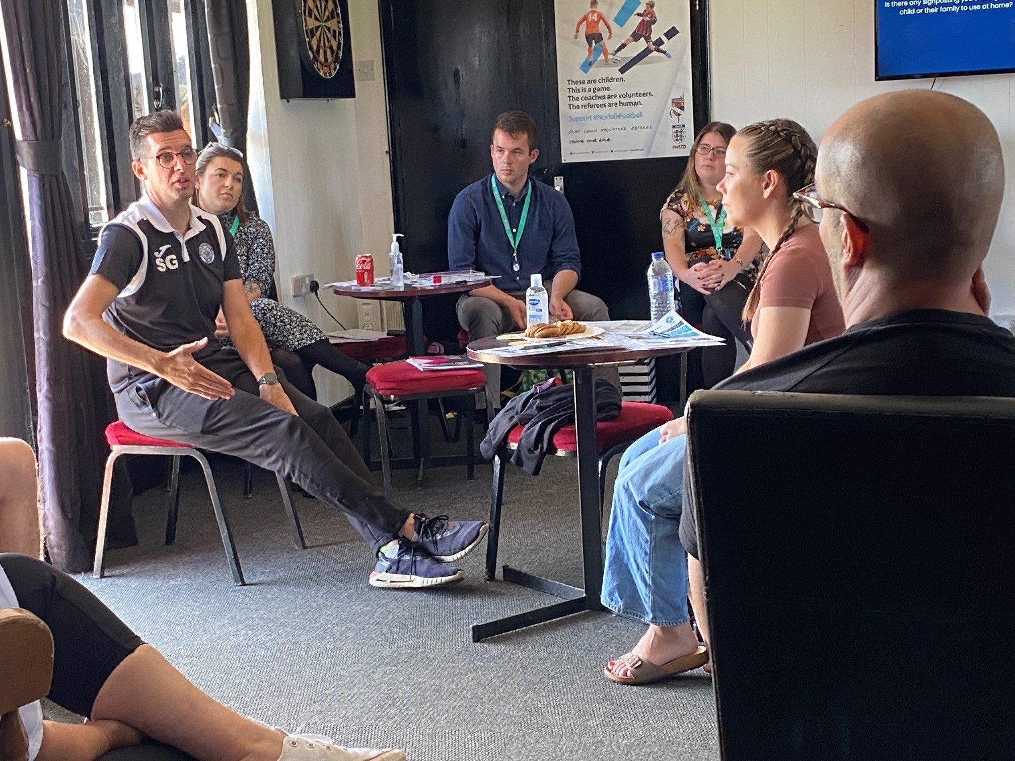 Staff discuss mental health at training