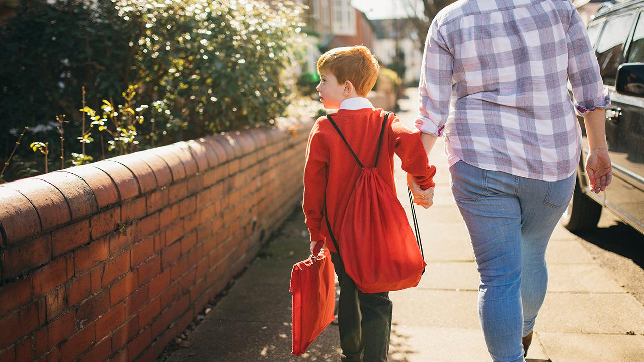 boy walks to school